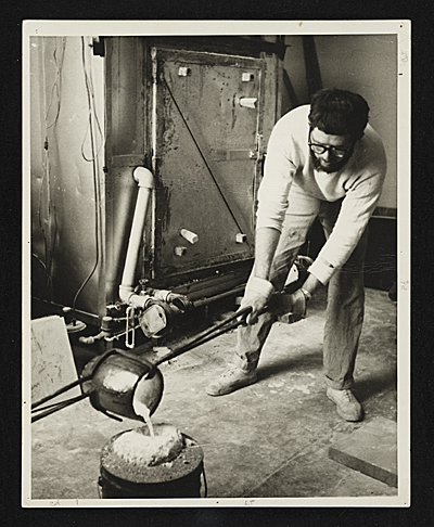 [Paul Suttman pouring bronze at the University of Michigan]
