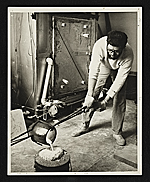 [Paul Suttman pouring bronze at the University of Michigan ]