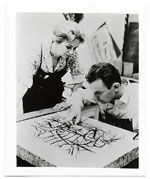 Romas Viesulas examining a lithographic stone with June Wayne