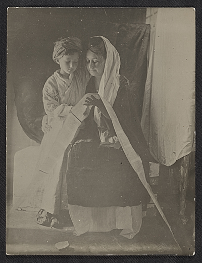 [Jessie Olssen Tanner and Jesse Ossawa Tanner posing for Henry Ossawa Tanner's painting Christ and his mother studying the scriptures ]