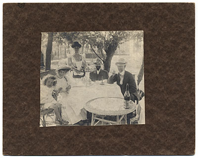 [Henry Tanner and family dining outdoors]