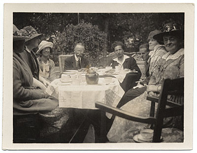 Henry O. Tanner, family and friends dining outdoors