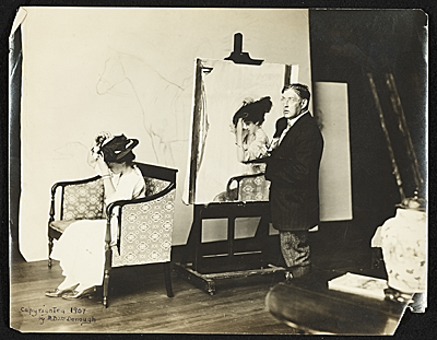 [Edmund C. Tarbell at work on Girl Putting on Her Hat]