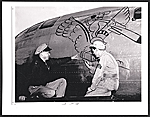 Sergeant Wayne Thiebaud painting on a B-29 aircraft at Mather Field, Calif.
