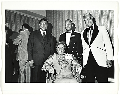 [Alma Thomas with three unidentified men]