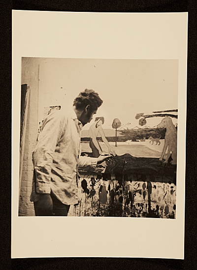 Bob Thompson painting in his studio