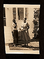 [Bob Thompson (14 years old) and his mother Bessie on their side lawn after his sister Phyllis' wedding ]