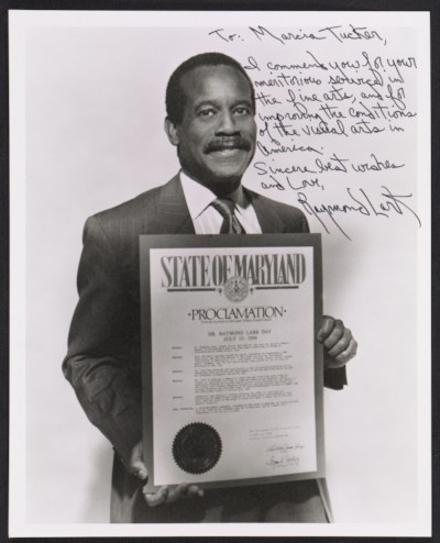 Photo of Raymond Lark with inscription to Marcia Tucker