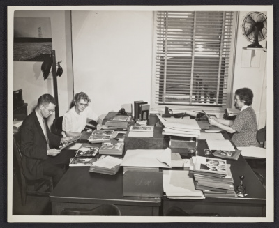 [Paul Vanderbilt and other staff at work]