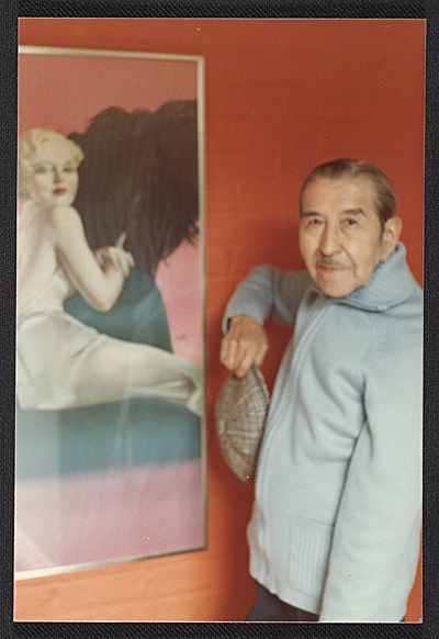 [Alberto Vargas with one of his portraits]