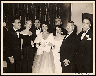 John Vassos (second from right), Elizabeth Taylor (center), and others at re-opening of the Egyptian Theatre in Los Angeles