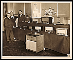 John Vassos and RCA colleagues with a display of RCA products