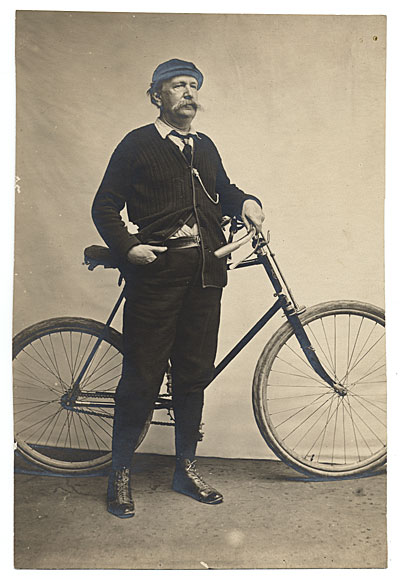 [Elihu Vedder with a bicycle]