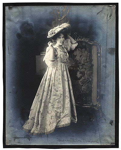 [Bessie Potter Vonnoh in a brocaded gown]