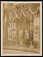 Workers standing in front of the Currier and Ives building in New York