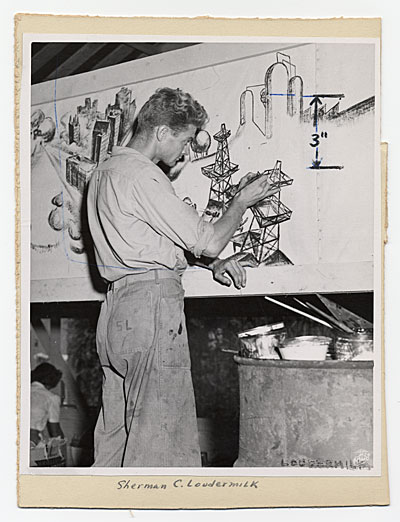 [Sherman C. Loudermilk working on a canvas]