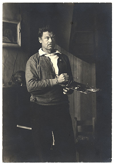 Henry Varnum Poor standing in his studio