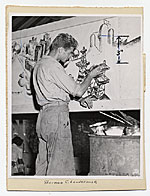 Sherman C. Loudermilk working on a canvas