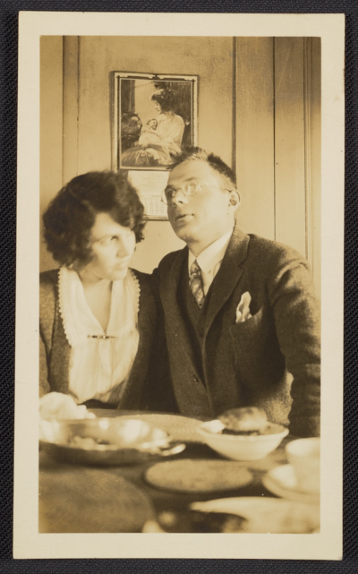 [Elizabeth and Coulton Waugh seated at a table]