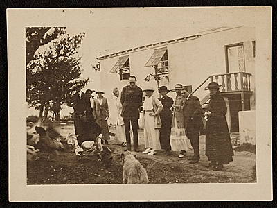 Edwin Ambrose Webster and others observing a dog and a group of ducks