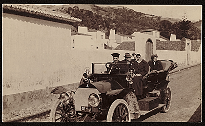 Edwin Ambrose Webster and Georgianna Webster with others traveling in a car