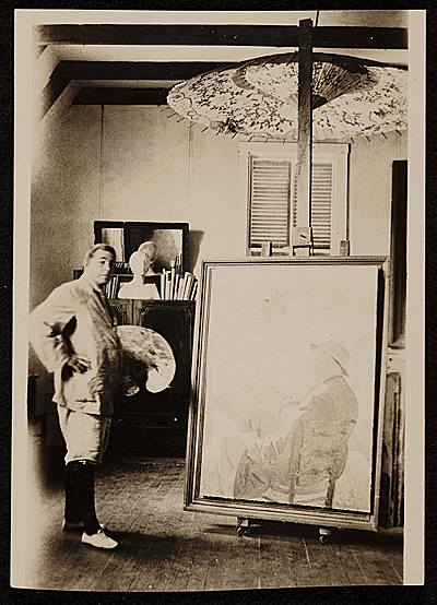 [Edwin Ambrose Webster painting in his studio]