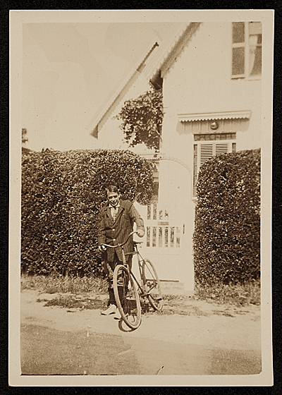[E. Ambrose Webster in front of his home on 180 Bradford St.]