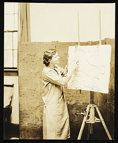 Katharine Lane Weems working on a frieze