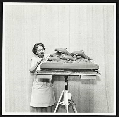 Katharine Weems working on Dolphins of the Sea