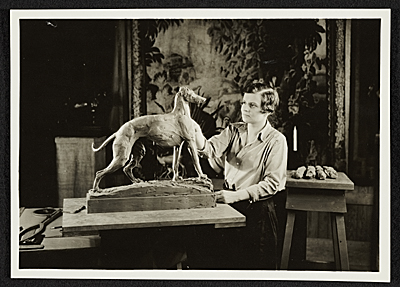 [Katharine Lane Weems working on a sculpture of a greyhound]