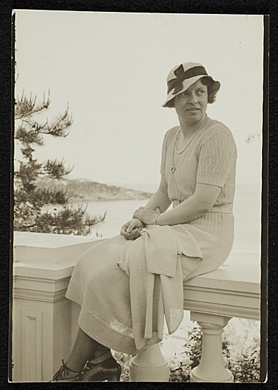 Katharine Lane Weems seated on a balustrade