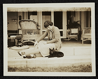 Katharine Ward Lane Weems seated with a dog