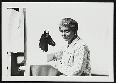 Katharine Lane Weems posing with one of her sculptures