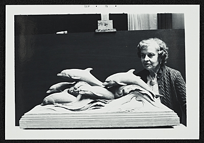 Katharine Weems with her sculpture Dolphins of the sea