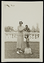 Katharine Ward Lane Weems standing next to a dog on a pedestal