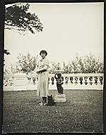 Katharine Ward Lane Weems posed with a dog at her feet