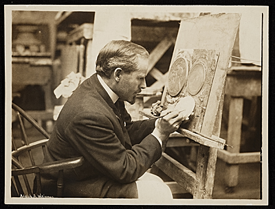 Adolph Weinman working in his studio