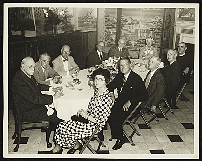 Adolph Weinman and group of people at dinner