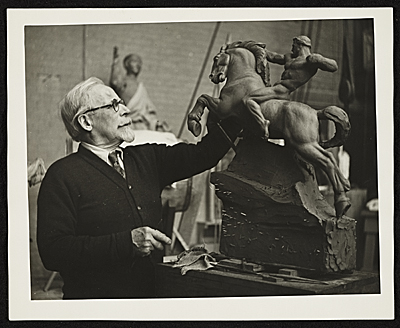 [Adolph Weinman with a model of his sculpture Riders of the Dawn]