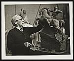Adolph Weinman with a model of his sculpture Riders of the Dawn