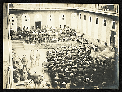 [View of YMCA inner courtyard with a musical entertainment for troops and staff, Baghdad, Persia.]