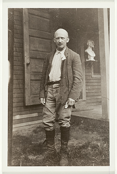 [Abbott Handerson Thayer standing in front of his Dublin, New Hampshire studio/home]