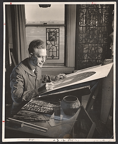 [Wilbur Herbert Burnham designing a stained glass window]