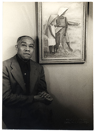 [Portrait of Ellis Wilson with a painting]
