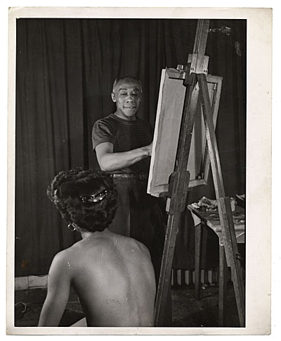 [Ellis Wilson painting with a model]