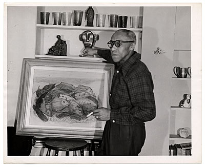 [Ellis Wilson with a painting of fish]