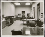 Otto Wittmann seated in his office as Director of the Toledo Museum of Art