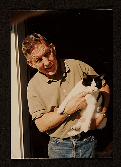 [Paul Wonner with cat at front door Jersey St., San Francisco]