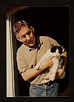 Paul Wonner with cat at front door Jersey St., San Francisco