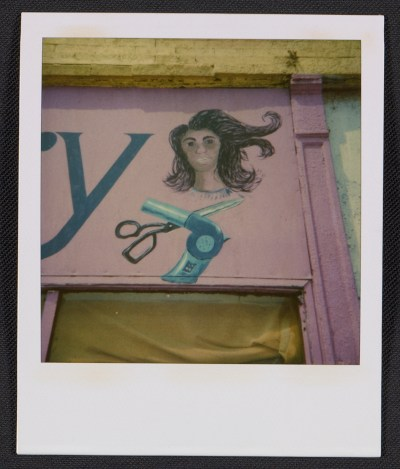 Detail of a beauty salon sign